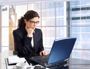 busy-business-woman-laptop-300x232